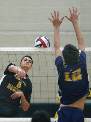McQuaid's Charlie Siragusa attacks as Victor's Max Meskos tries to block in the second set during the Section V Boys Volleyball quarterfinal at McQuaid Jesuit High School. McQuaid won in three straight games.