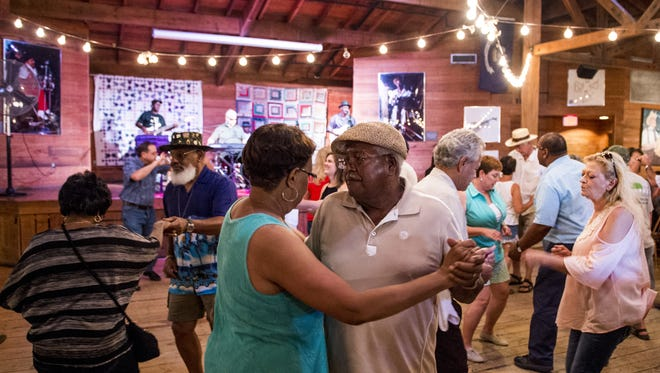 Couples dance during a performance by Lil Buck Sinegal at last year's Creole Culture Day at Vermilionville.