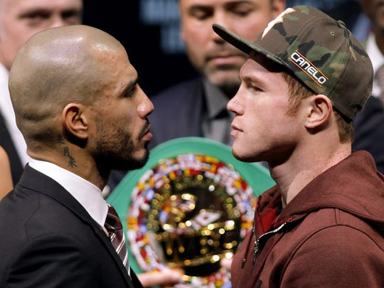 "Miguel Cotto, left, and Saul '""Canelo'""Alvarez face off during a news conference in Las Vegas."