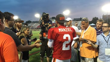 Cleveland's Johnny Manziel meets with reporters during joint practices with the Buffalo Bills last summer at St. John Fisher College. Manziel was coming off a stint in rehab and had high hopes for a new start, but the Browns will release him on or before March 9.