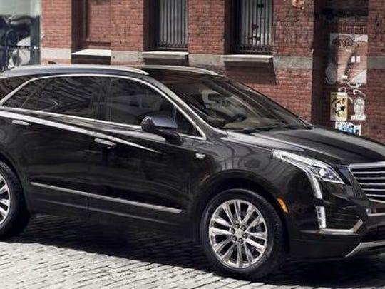This file image shows a Cadillac XT5, a mid-size crossover produced at GM's Spring Hill plant in Tennessee. Analysts project that a larger crossover could be made in Lansing once it stops producing the 2016 GMC Acadia models.