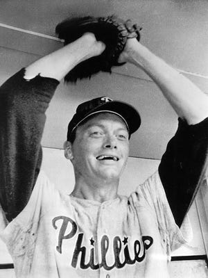 Jim Bunning gives a victory gesture after pitching a perfect game against the New York Mets at Shea Stadium in New York Sunday. He led the Philadelphia Phillies to a 6-0 win to make baseball history by not letting a single batter reach first base. The feat has been accomplished only nine times in major league history. June 1964