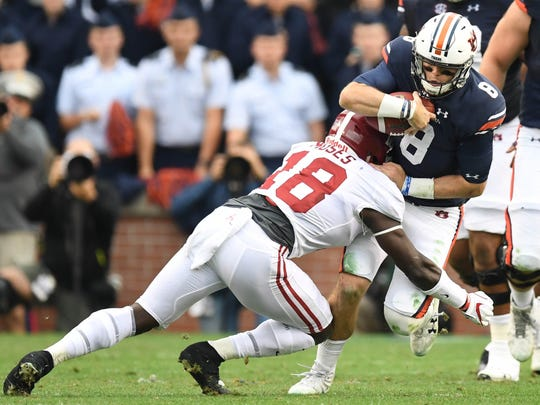 Nov 25, 2017; Auburn, AL, USA; Auburn Tigers quarterback Jarrett Stidham (8) runs the ball as Alabama Crimson Tide linebacker Dylan Moses defends during the second quarter at Jordan-Hare Stadium. Mandatory Credit: Christopher Hanewinckel-USA TODAY Sports