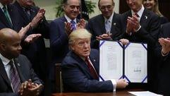 President Trump holds up the Veterans Choice Program