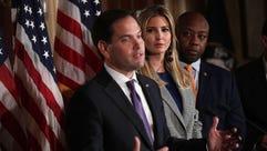 Florida GOP Sen. Marco Rubio (L) speaks as Ivanka Trump
