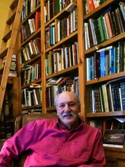 Rick Snipes of Aspermont, a recent winner of the T. Boone Pickens award, sits in his home library, located at his ranch near Aspermont.