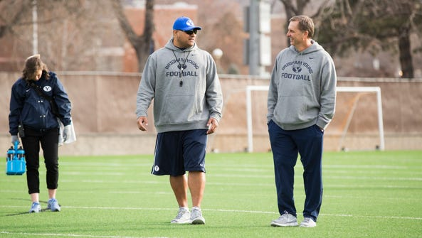Former players Kalani Sitake (left) and Ty Detmer are