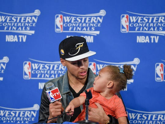 Stephen Curry and daughter Riley.