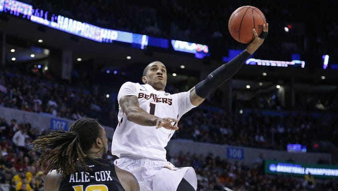 Oregon State guard Gary Payton II (1) goes up for a shot in front of Virginia Commonwealth forward Mo Alie-Cox (12) in the second half of a first-round men's college basketball game in the NCAA Tournament, Friday, March 18, 2016, in Oklahoma City. VCU won 75-67. (AP Photo/Sue Ogrocki)