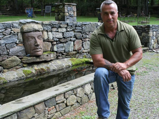 Charlie Frattini poses at his home in Croton June 10, 2014.  Frattini is on A&E's Sell This House