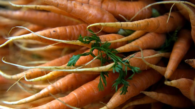 Carrots sold at the downtown Farmer's Market on Main Street between San Joaquin and Hunter Street in Stockton.