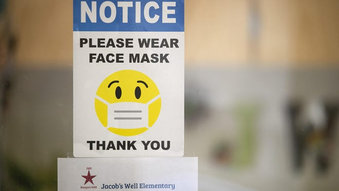 A sign, shown here in September, requires face masks at Jacob's Well Elementary School in Wimberley. [JAY JANNER/AMERICAN-STATESMAN/FILE]