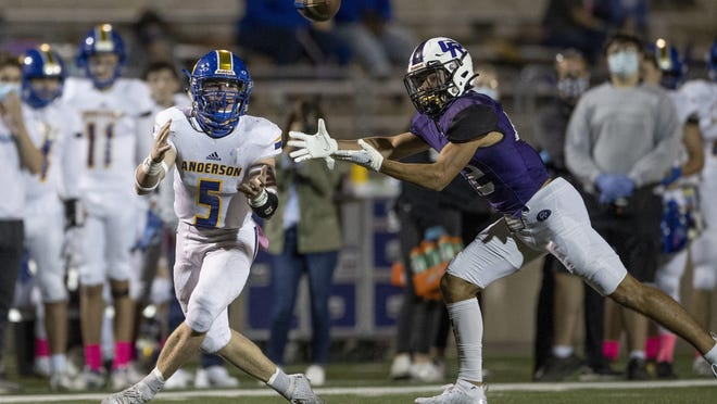 Anderson defensive back Will Fonken, left, knocks out of bounds Cedar Ridge wide receiver DJ Rountree in the first quarter Friday at Kelly Reeves Athletic Complex. Cedar Ridge raced out to an early lead and cruised to a 46-14 win in a nondistrict contest.