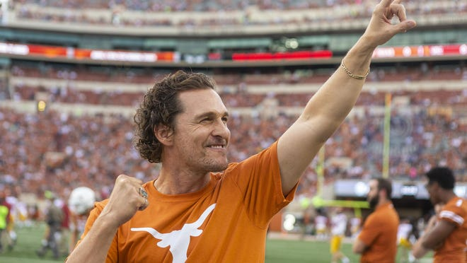 Matthew McConaughey gives the Hook 'Em Horns sign to the crowd before an NCAA football game at Royal-Memorial Stadium, Saturday, Sept. 15, 2018. [Stephen Spillman for Statesman)