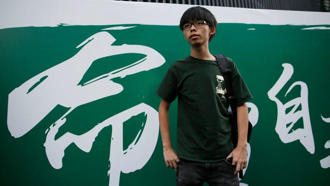 Joshua Wong, 17-year-old student leader, poses for photographers on the stage after a press conference in the occupied areas at Central district Oct. 9 in Hong Kong.