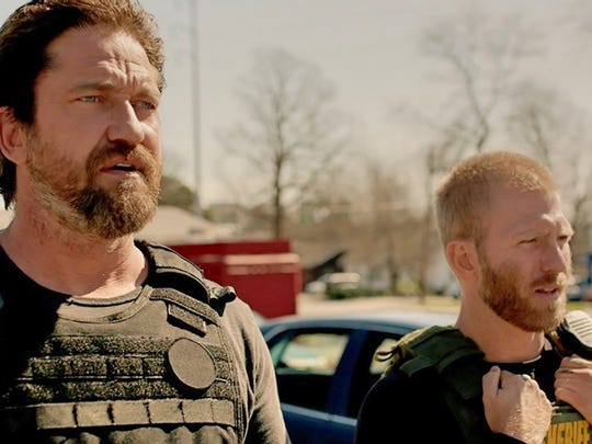 "Gerard Butler (left) and Kaiwi Lyman star in ""Den of"
