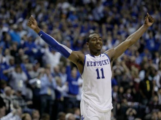 Kentucky guard John Wall (11) celebrates beating Mississippi State in overtime to win the championship game at the NCAA college basketball Southeastern Conference tournament on Sunday, March 14, 2010, in Nashville, Tenn.