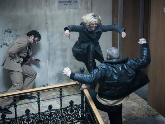 "Charlize Theron, center, in ""Atomic Blonde."""