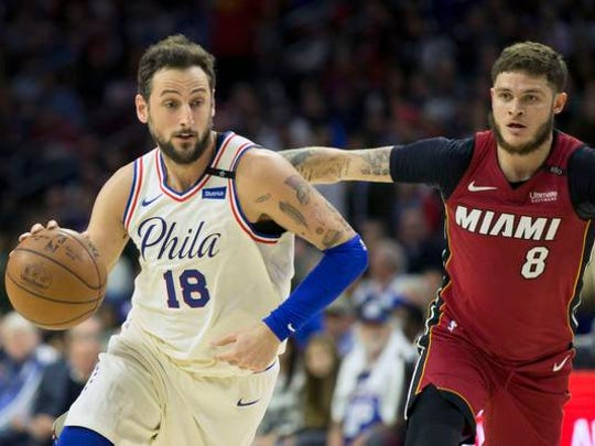 Apr 24, 2018; Philadelphia, PA, USA; Philadelphia 76ers guard Marco Belinelli (18) dribbles past Miami Heat guard Tyler Johnson (8) during the third quarter in game five of the first round of the 2018 NBA Playoffs at Wells Fargo Center. Mandatory Credit: Bill Streicher-USA TODAY Sports