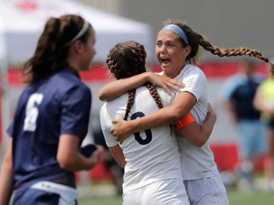 Bay Port High School's Emma Nagel (1) celebrates scoring