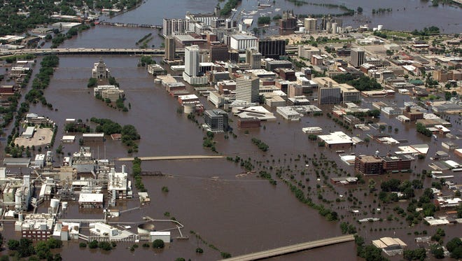 Downtown Cedar Rapids is engulfed by the Cedar River on June 13, 2008.