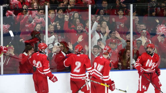 North Rockland players celebrate their second goal of the game with their fans during Section 1 playoff game against Mamaroneck at Hommocks Park Ice Rink in Mamaroneck Feb. 23, 2018. North Rockland won the game 2-0.