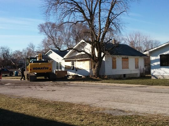 Demolition begins on the former Ammons home on Carolina
