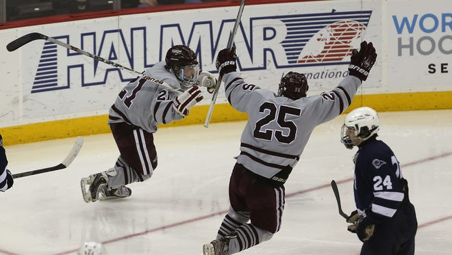 Morristown's Teddy Dolan (21) celebrates his goal vs. Randolph in the NJSIAA Public A hockey final at the Prudential Center in Newark. The Colonials won 2-0. March 7, 2016. Newark, N.J.