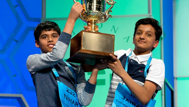 Nihar Janga, 11, of Austin, and Jairam Hathwar, 13, of Painted Post, N.Y., hold up the trophy after being named co-champions.