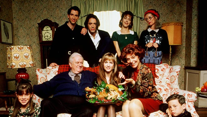 The cast of  Home for the Holidays - Dylan McDermott, top left, Robert Downey, Jr., Cynthia Stevenson, Geraldine Chaplin,  Charles Durning, seated left, Holly Hunter, Anne Bancroft, and kids Emily Ann Lloyd, left, and Zachary Duhame.