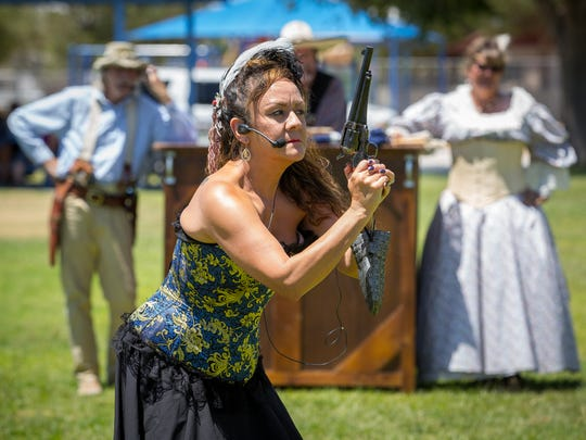"Myra Luna raises a gun while playing the part of a wild west prostitute, or ""soiled dove"", during the Six Guns & Shady Ladies western show during the Second Annual National Day of the Cowboy celebration at Richard H. White Park in Anthony, TX, Saturday, July 23, 2016."