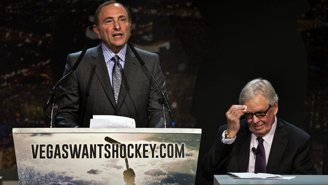"""In this Feb. 10, 2015, file photo, Gary Bettman, commissioner of the National Hockey League addresses the crowd as Bill Foley, chairman, Fidelity National Financial, Inc., Black Knight and FIS wipes his forehead during the """"Let's Bring Hockey to Las Vegas!"""" press conference at the MGM Grand Ballroom in Las Vegas. A person with direct knowledge of the NHL's decision says the league has settled on Las Vegas as its choice for expansion, provided organizers can come up with a $500 million fee. The person spoke Tuesday, June 14, 2016, on condition of anonymity because details have not been released by the league ahead of its Board of Governors meeting on June 22."""