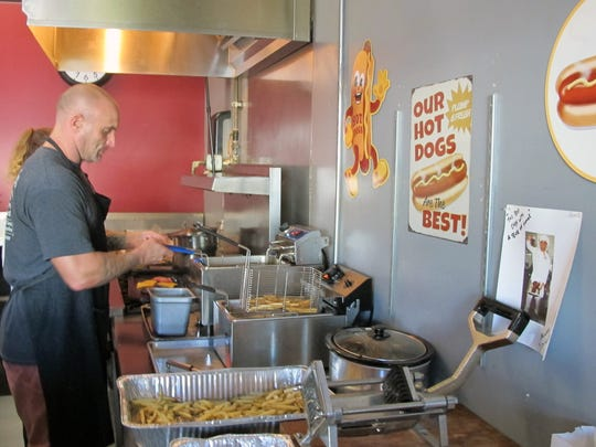 Chris DeLuca make hand-cut fries at DeLuca's Burgers and Fries which recently opened for lunch on Yahl Street in North Naples.
