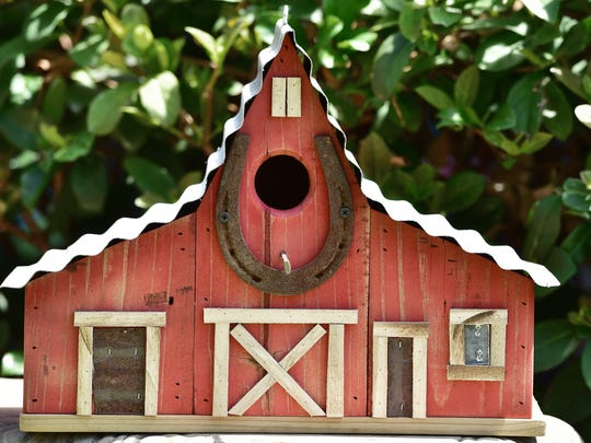 A traditional barn design with an entry suitable for bluebirds, wrens and finches.