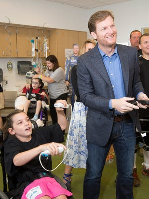Dale Earnhardt Jr. plays Wii Boxing with Maddie Delaney during a 2016 visit to Nationwide Children's Hospital in Columbus, Ohio.