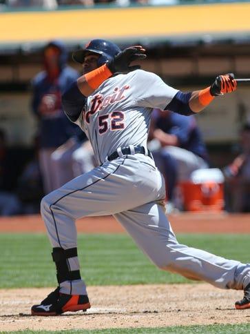 Yoenis Cespedes hits a three-run home run against his
