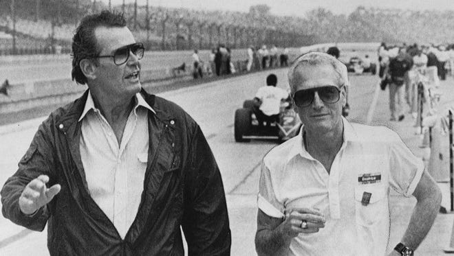 Actors James Garner and Paul Newman walk the pits at the 1985 Indianapolis 500.