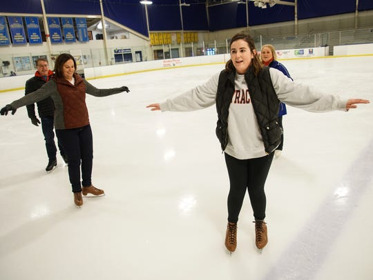 News Journal staffers Meredith Newman and Sarika Jagtiani learned how to ice skate from University of Delaware skating coaches (and former Olympians) Suzy Semanick Schurman and Scott Gregory.