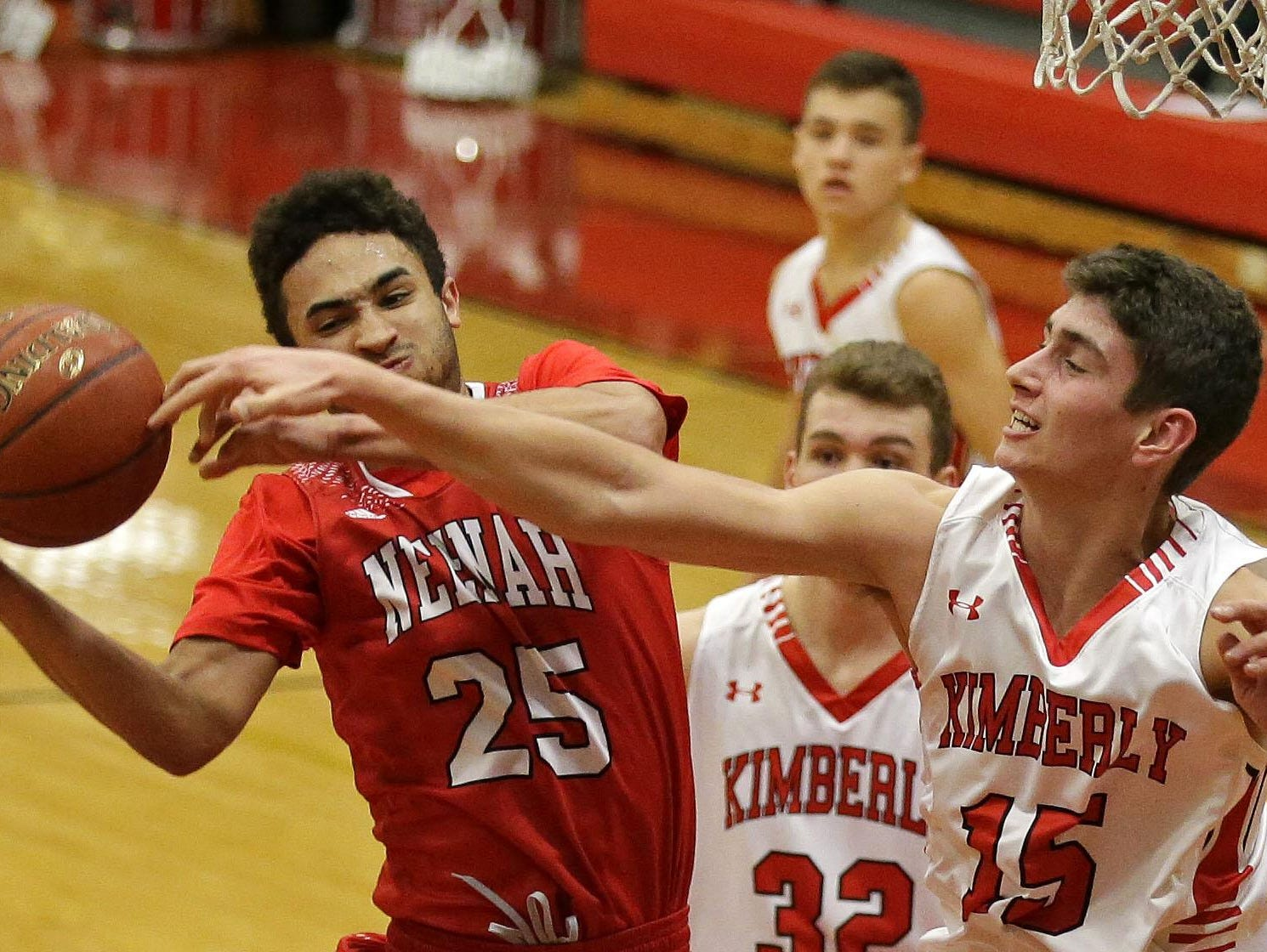 Zavier Sims of Neenah goes up strong against Kimberly's Danny Vanden Boom in a recent Fox Valley Association basketball game. Sims, a senior, has battled back from brain surgery prior to his freshman year.