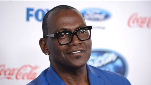 """In this file photo, Randy Jackson attends FOX's """"American Idol XIII"""" finalists party at Fig & Olive Melrose Place in West Hollywood, Calif.  Fox and the producers of """"American Idol"""" say Jackson is exiting the show after 13 seasons. In a statement Tuesday, the network and producers called Jackson a key part of the singing contest, and said he'd be welcome back as a visitor."""