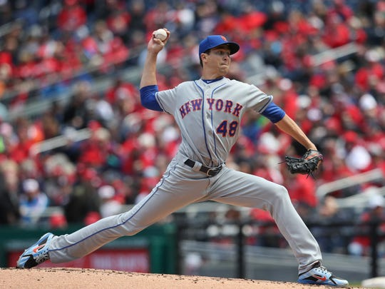 New York Mets starting pitcher Jacob deGrom (48) delivers against the Washington Nationals during the second inning of home opener baseball game, at Nationals Park, Thursday, April 5, 2018, in Washington.