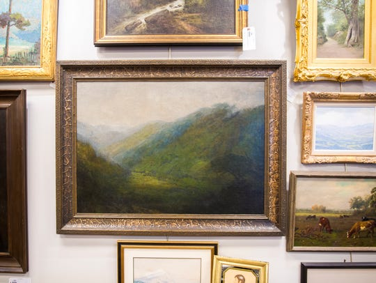 A painting of the Smoky Mountains by artist Charles Krutch at Case Antiques. Case Antiques is hosting its first auction in their newly expanded gallery headquarters located at 4310 Papermill Drive on July 14, 2018.