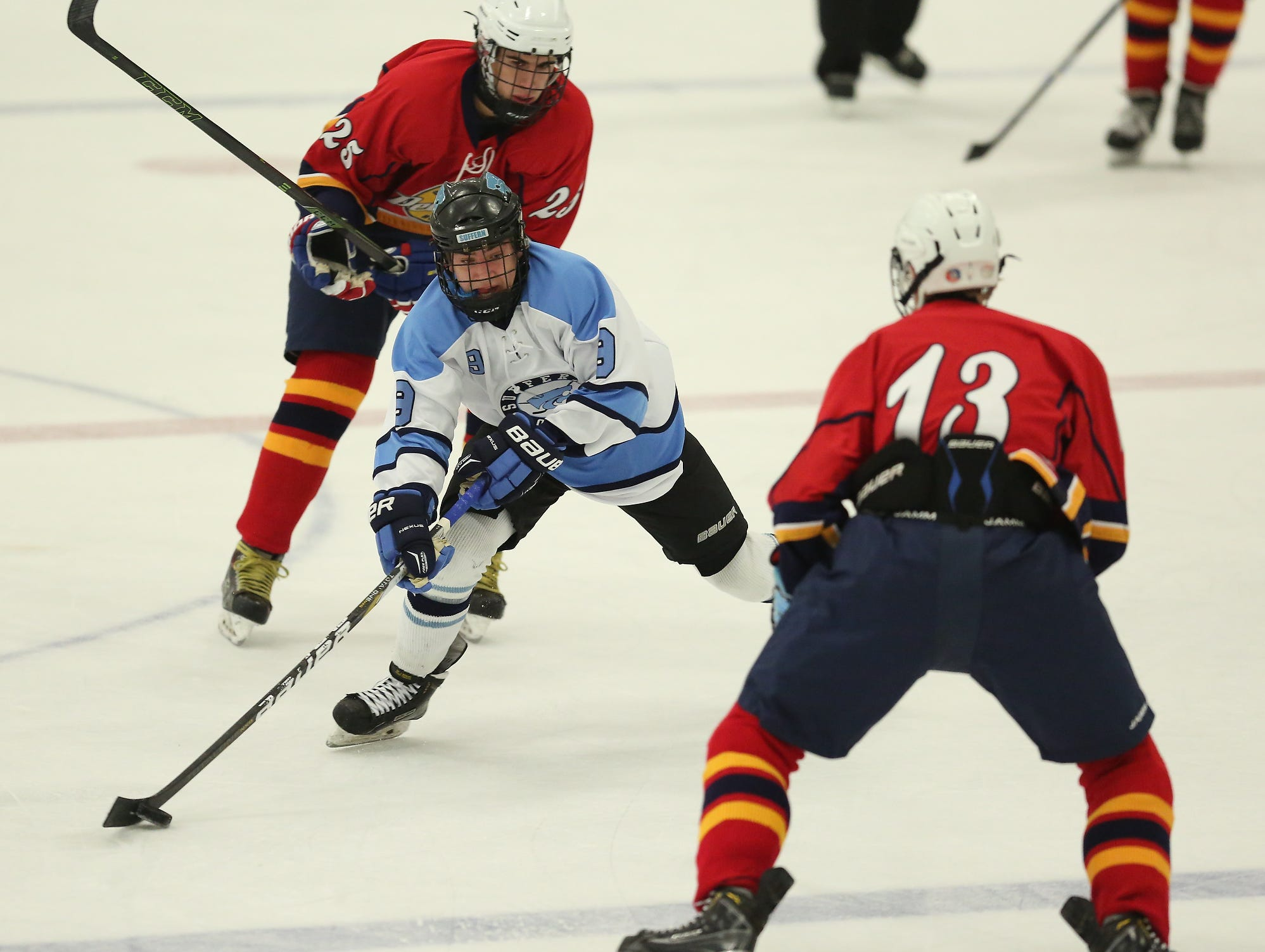 Suffern's Tim Patwell (9) skates the puck across the red-line during a varsity ice hockey game at Sport -O-Rama in Monsey on Saturday, Nov. 28, 2015.