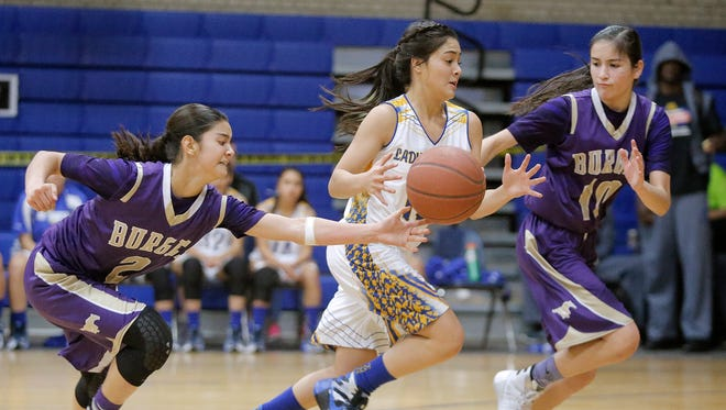 Eastwood's Bianca Robinson has the ball stolen by Becca Cardenas of Burges while trying to avoid Natalie Sanchez, right, during the McDonald's Classic Basketball Tournament on Friday at Eastwood High School.