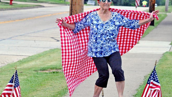 Jenni Ruesser leads off the Hometown Homemade Parade on Tuesday in Orrville that she organized, keeping the city's tradition of having an annual parade the Tuesday before the Fourth of July holiday.
