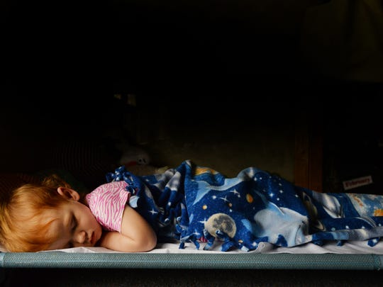 Chaseleigh Hampton sleeps peacefully in her cot at the daycare center of the Providence House.
