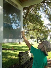 Debbie Avery took this photo of Chandler Hooker, the son of Sunrise Rotary of Vero Beach board member Ray Hooker, giving the Little Free Library a once over at Troy Moody Park in Vero Beach.