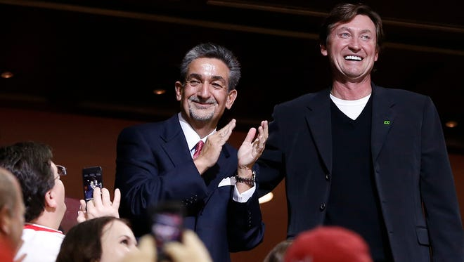 Hockey Hall of Famer Wayne Gretzky, right, attended a Capitals game last month with owner Ted Leonsis.