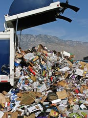 A truck dumps its load into a recyclable mountain on the floor, at Palm Springs Disposal Services on Jun. 6, 2015. After being collected, recyclables are transported to a Materials Recovery Facility where they are separated and shipped off to be processed into new products.