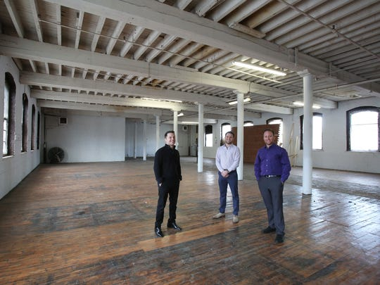 Jordan Rose, left, and his brothers Harlan and Austin of R.J. Rose Realty in their renovated industrial building in Yonkers.